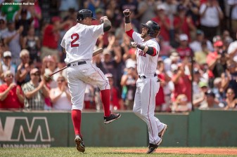 BOSTON, MA - JULY 27: Dustin Pedroia #15 of the Boston Red Sox high fives Xander Bogaerts #2 after hitting a solo home run during the first inning of a game against the Detroit Tigers on July 27, 2016 at Fenway Park in Boston, Massachusetts. (Photo by Billie Weiss/Boston Red Sox/Getty Images) *** Local Caption *** Dustin Pedroia; Xander Bogaerts
