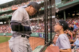BOSTON, MA - AUGUST 11: Alex Rodriguez #13 of the New York Yankees greets fan Jacob Doherty, 10, of Wilmington, Massachusetts, as he warms up on deck during the first inning of a game against the Boston Red Sox on August 11, 2016 at Fenway Park in Boston, Massachusetts.(Photo by Billie Weiss/Boston Red Sox/Getty Images) *** Local Caption *** Alex Rodriguez; Jacob Doherty