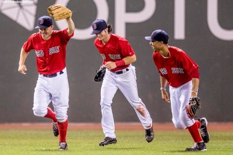 BOSTON, MA - AUGUST 12: Brock Holt #12, Andrew Benintendi #40, and Mookie Betts #50 of the Boston Red Sox celebrate a victory against the Arizona Diamondbacks on August 12, 2016 at Fenway Park in Boston, Massachusetts. (Photo by Billie Weiss/Boston Red Sox/Getty Images) *** Local Caption *** Mookie Betts; Andrew Benintendi; Brock Holt