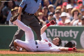 BOSTON, MA - AUGUST 14: Andrew Benitendi #40 of the Boston Red Sox is tagged out as he slides into home during the second inning of a game against the Arizona Diamondbacks on August 14, 2016 at Fenway Park in Boston, Massachusetts. (Photo by Billie Weiss/Boston Red Sox/Getty Images) *** Local Caption *** Andrew Benintendi