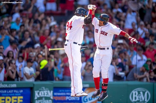 BOSTON, MA - AUGUST 14: Mookie Betts #50 of the Boston Red Sox reacts with David Ortiz #34 after hitting a home run during the fifth inning of a game against the Arizona Diamondbacks on August 14, 2016 at Fenway Park in Boston, Massachusetts. It was his third home run of the day. (Photo by Billie Weiss/Boston Red Sox/Getty Images) *** Local Caption *** Mookie Betts; David Ortiz