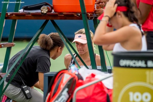 August 21, 2016, New Haven, Connecticut: Lesia Tusrenko of Ukraine receives medical treatment in action during Day 3 of the 2016 Connecticut Open at the Yale University Tennis Center on Sunday, August 21, 2016 in New Haven, Connecticut. (Photo by Billie Weiss/Connecticut Open)