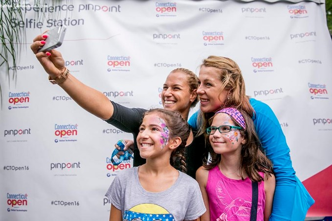 August 21, 2016, New Haven, Connecticut: Fans pose for a selfie photograph with Dominica Cibulkova and Anastasia Pavlyuchenkova during Day 3 of the 2016 Connecticut Open at the Yale University Tennis Center on Sunday, August 21, 2016 in New Haven, Connecticut. (Photo by Billie Weiss/Connecticut Open)