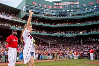 BOSTON, MA - AUGUST 26: Olympic gymnast Aly Raisman is introduced alongside David Ortiz #34 of the Boston Red Sox before throwing out a ceremonial first pitch before a game against the Kansas City Royals on August 26, 2016 at Fenway Park in Boston, Massachusetts. (Photo by Billie Weiss/Boston Red Sox/Getty Images) *** Local Caption *** David Ortiz; Aly Raisman