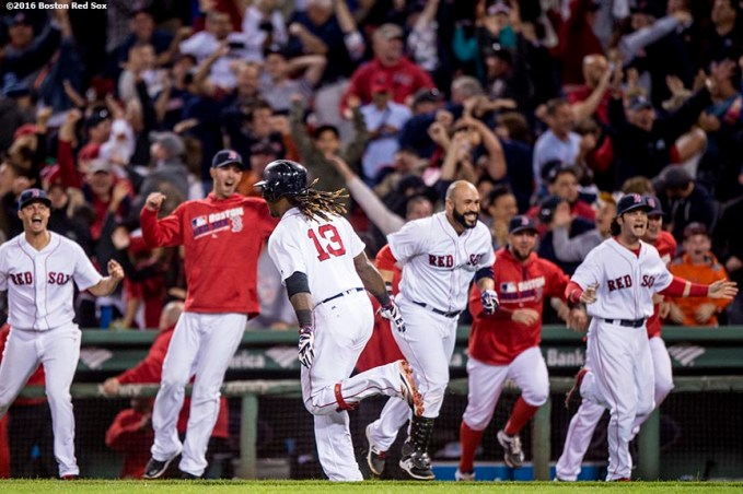 BOSTON, MA - SEPTEMBER 15: Hanley Ramirez #13 of the Boston Red Sox reacts as teammates run out of the dugout after hitting a walk off three run home run during the ninth inning of a game against the New York Yankees on September 15, 2016 at Fenway Park in Boston, Massachusetts. (Photo by Billie Weiss/Boston Red Sox/Getty Images) *** Local Caption *** Hanley Ramirez
