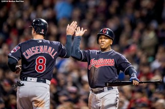 BOSTON, MA - OCTOBER 10: Jose Ramirez #11 and Lonnie Chisenhall #8 of the Cleveland Indians high five after scoring during the fourth inning of game three of the American League Division Series against the Boston Red Sox on October 10, 2016 at Fenway Park in Boston, Massachusetts. (Photo by Billie Weiss/Boston Red Sox/Getty Images) *** Local Caption *** Jose Ramirez