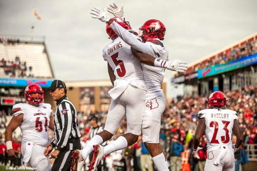 CHESTNUT HILL, MA - NOVEMBER 05: Jaylen Smith #9 of Louisville reacts with Kamrin Moore #5 after catching a touchdown pass during the first quarter of a game against Boston College at Alumni Stadium on November 5, 2016 in Chestnut Hill, Massachusetts. (Photo by Billie Weiss/Getty Images) *** Local Caption *** Jaylen Smith; Kamrin Moore