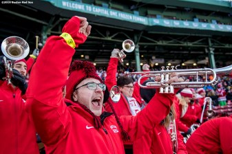 BOSTON, MA - JANUARY 08: A member of the band cheers as Boston University plays the University of Massachusetts during a Frozen Fenway game at Fenway Park on January 8, 2017 in Boston, Massachusetts. (Photo by Billie Weiss/Boston Red Sox/Getty Images)