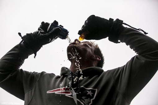 BOSTON, MA - FEBRUARY 07: Rob Gronkowsk of the New England Patriots drinks beers during the Super Bowl victory parade on February 7, 2017 in Boston, Massachusetts. The Patriots defeated the Atlanta Falcons 34-28 in overtime in Super Bowl 51. (Photo by Billie Weiss/Getty Images) *** Local Caption *** Rob Gronkowski