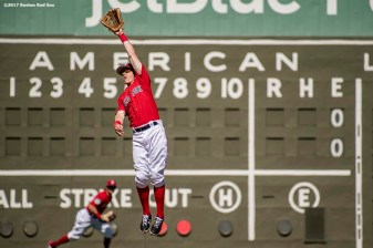FT. MYERS, FL - FEBRUARY 24: Brock Holt #12 of the Boston Red Sox jumps as he attempts to catch a line drive during the first inning of a game against the New York Mets on February 24, 2017 at Fenway South in Fort Myers, Florida . (Photo by Billie Weiss/Boston Red Sox/Getty Images) *** Local Caption *** Brock Holt