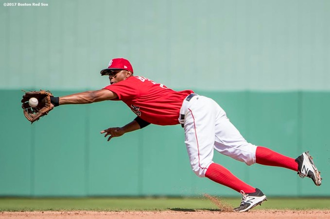 FT. MYERS, FL - FEBRUARY 27: Xander Bogaerts #2 of the Boston Red Sox attempts to make a diving catch during the third inning of a Spring Training game against the St. Louis Cardinals on February 27, 2017 at Fenway South in Fort Myers, Florida . (Photo by Billie Weiss/Boston Red Sox/Getty Images) *** Local Caption *** Xander Bogaerts
