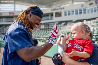 FT. MYERS, FL - FEBRUARY 28: Hanley Ramirez #13 of the Boston Red Sox greets a young fan before a Spring Training game against the New York Yankees on February 28, 2017 at Fenway South in Fort Myers, Florida . (Photo by Billie Weiss/Boston Red Sox/Getty Images) *** Local Caption *** Hanley Ramirez