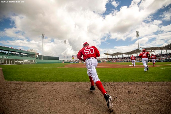 FT. MYERS, FL - MARCH 2: Mookie Betts #50 of the Boston Red Sox runs onto the field before the first inning of a Spring Training game against the Tampa Bay Rays on March 2, 2017 at Fenway South in Fort Myers, Florida . (Photo by Billie Weiss/Boston Red Sox/Getty Images) *** Local Caption *** Mookie Betts