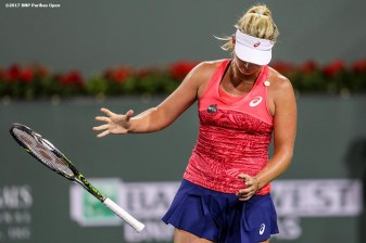 Coco Vandeweghe throws her racquet in frustration during a match against against Lucie Safarova at the Indian Wells Tennis Garden in Indian Wells, California on Saturday, March 11, 2017. (Photo by Billie Weiss/BNP Paribas Open)