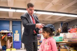 March 27, 2017, Boston, MA: Boston Mayor Marty Walsh gives Boston Red Sox hats to students during a visit to the Hennigan School in Jamaica Plain, Massachusetts Monday, March 27, 2017. (Photo by Billie Weiss/Boston Red Sox)