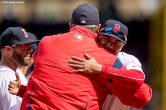 BOSTON, MA - APRIL 3: Mookie Betts #50 of the Boston Red Sox hugs manager John Farrell as he is introduced before the home opener against the Pittsburgh Pirates April 3, 2017 at Fenway Park in Boston, Massachusetts. (Photo by Billie Weiss/Boston Red Sox/Getty Images) *** Local Caption *** Mookie Betts; John Farrell