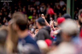 BOSTON, MA - APRIL 15: A fan reacts after catching a foul ball during a game between the Boston Red Sox and the Tampa Bay Rays on April 15, 2017 at Fenway Park in Boston, Massachusetts. (Photo by Billie Weiss/Boston Red Sox/Getty Images) *** Local Caption ***