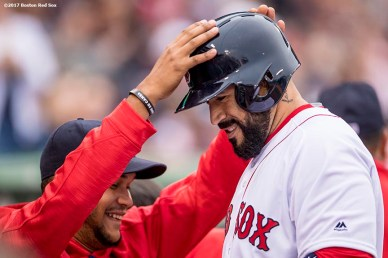 BOSTON, MA - APRIL 15: Sandy Leon #3 of the Boston Red Sox reacts with Eduardo Rodriguez #52 after hitting an RBI fielder's choice ground out during the seventh inning of a game against the Tampa Bay Rays on April 15, 2017 at Fenway Park in Boston, Massachusetts. (Photo by Billie Weiss/Boston Red Sox/Getty Images) *** Local Caption *** Sandy Leon; Eduardo Rodriguez
