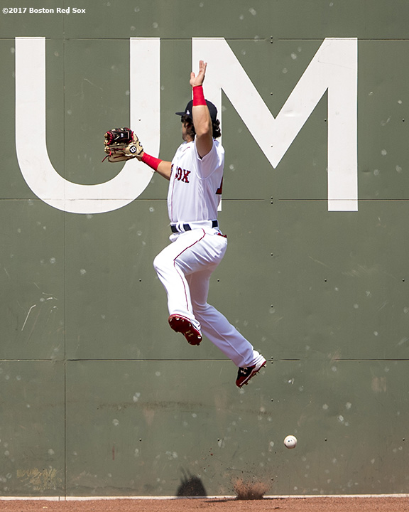 BOSTON, MA - APRIL 16: Andrew Benintendi #16 of the Boston Red Sox attempts to catch a fly ball but cannot make the catch during the first inning inning of a game against the Tampa Bay Rays on April 16, 2017 at Fenway Park in Boston, Massachusetts. (Photo by Billie Weiss/Boston Red Sox/Getty Images) *** Local Caption *** Andrew Benintendi