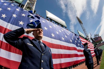 BOSTON, MA - APRIL 17: A member of the Hanscomb Air Force Base salutes as the American flag is dropped over the Green Monster before a game between the Boston Red Sox and the Tampa Bay Rays on April 17, 2017 at Fenway Park in Boston, Massachusetts. (Photo by Billie Weiss/Boston Red Sox/Getty Images) *** Local Caption ***