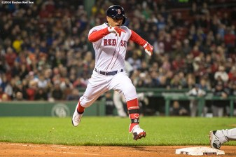 BOSTON, MA - APRIL 26: Mookie Betts #50 of the Boston Red Sox beats out a ground ball during the fourth inning of a game against the New York Yankees on April 26, 2017 at Fenway Park in Boston, Massachusetts. (Photo by Billie Weiss/Boston Red Sox/Getty Images) *** Local Caption *** Mookie Betts