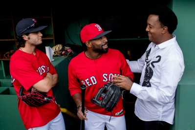 BOSTON, MA - APRIL 28: Former pitcher Pedro Martinez talks with Jackie Bradley Jr. #19 of the Boston Red Sox before a game against the Chicago Cubs on April 28, 2017 at Fenway Park in Boston, Massachusetts. (Photo by Billie Weiss/Boston Red Sox/Getty Images) *** Local Caption *** Jackie Bradley Jr.; Pedro Martinez