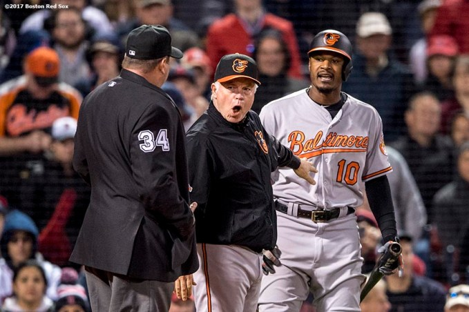 BOSTON, MA - MAY 3: Adam Jones #10 and manager Buck Showalter of the Baltimore Orioles argue with home plate umpire Sam Holbrook after being ejected from the game after striking out during the fourth inning of a game against the Baltimore Orioles on May 3, 2017 at Fenway Park in Boston, Massachusetts. (Photo by Billie Weiss/Boston Red Sox/Getty Images) *** Local Caption *** Adam Jones; Sam Holbrook; Buck Showalter