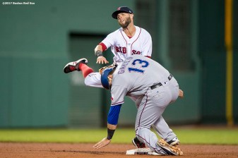 BOSTON, MA - MAY 24: Dustin Pedroia #15 of the Boston Red Sox turns a double play over Joey Gallo #13 of the Texas Rangers during the fifth inning of a game on May 24, 2017 at Fenway Park in Boston, Massachusetts. (Photo by Billie Weiss/Boston Red Sox/Getty Images) *** Local Caption *** Dustin Pedroia; Joey Gallo