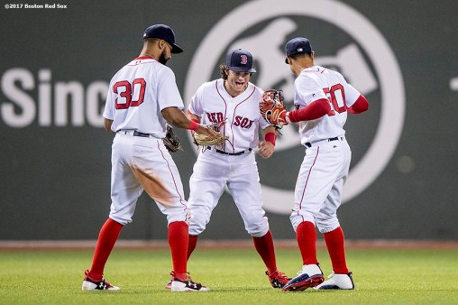 BOSTON, MA - MAY 24: Chris Young #30, Andrew Benintendi #16, and Mookie Betts #50 of the Boston Red Sox celebrate a victory against the Texas Rangers on May 24, 2017 at Fenway Park in Boston, Massachusetts. (Photo by Billie Weiss/Boston Red Sox/Getty Images) *** Local Caption *** Andrew Benintendi; Chris Young; Mookie Betts