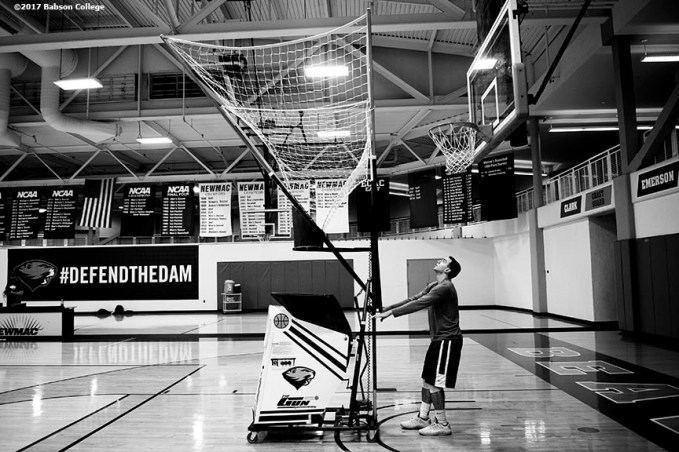 November 30, 2016, Newton, MA: Sam Bohmiller sets up a ball machine to warm up before a game against Bates University at Webster Sports Arena at Babson College in Newton, Massachusetts Wednesday, November 30, 2016. (Photo by Billie Weiss/Babson College Magazine)