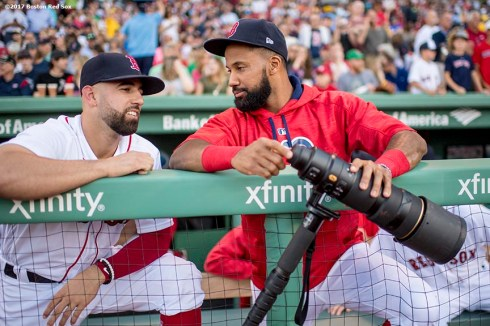 BOSTON, MA - JUNE 9: Chris Young #30 and Deven Marrero #17 of the Boston Red Sox pick up a camera lens before a game against the Detroit Tigers on June 9, 2017 at Fenway Park in Boston, Massachusetts. (Photo by Billie Weiss/Boston Red Sox/Getty Images) *** Local Caption *** Chris Young; Deven Marrero