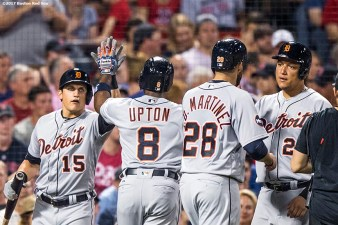 BOSTON, MA - JUNE 11: Justin Upton #8 of the Detroit Tigers high fives J.D. Martinez #4, Mikie Mahtook #15, and Miguel Cabrera #24 after hitting a grand slam during the fifth inning of a game against the Boston Red Sox on June 11, 2017 at Fenway Park in Boston, Massachusetts. (Photo by Billie Weiss/Boston Red Sox/Getty Images) *** Local Caption *** Justin Upton; J.D. Martinez; Miguel Cabrera, Mikie Mahtook