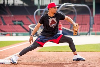 BOSTON, MA - JUNE 13: Mookie Betts #50 of the Boston Red Sox fields ground balls at first base before a game against the Philadelphia Phillies on June 13, 2017 at Fenway Park in Boston, Massachusetts. (Photo by Billie Weiss/Boston Red Sox/Getty Images) *** Local Caption *** Mookie Betts