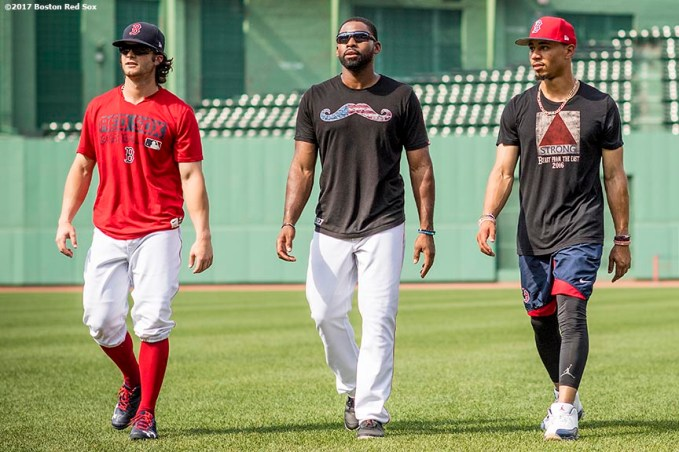 BOSTON, MA - JUNE 13: Andrew Benintendi #16, Jackie Bradley Jr. #19, and Mookie Betts #50 of the Boston Red Sox walk off the field before a game against the Philadelphia Phillies on June 13, 2017 at Fenway Park in Boston, Massachusetts. (Photo by Billie Weiss/Boston Red Sox/Getty Images) *** Local Caption *** Andrew Benintendi; Jackie Bradley Jr.; Mookie Betts