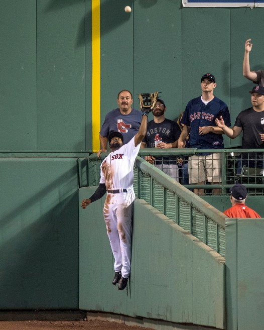 BOSTON, MA - JULY 16: Jackie Bradley Jr. #19 of the Boston Red Sox leaps over the wall to rob a home run ball hit by Aaron Judge #99 of the New York Yankees during the eighth inning of a game on July 16, 2017 at Fenway Park in Boston, Massachusetts. (Photo by Billie Weiss/Boston Red Sox/Getty Images) *** Local Caption *** Jackie Bradley Jr.; Aaron Judge