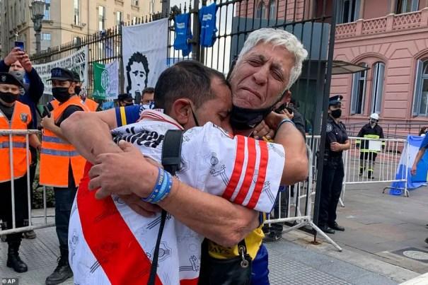 TWO MEN HUG