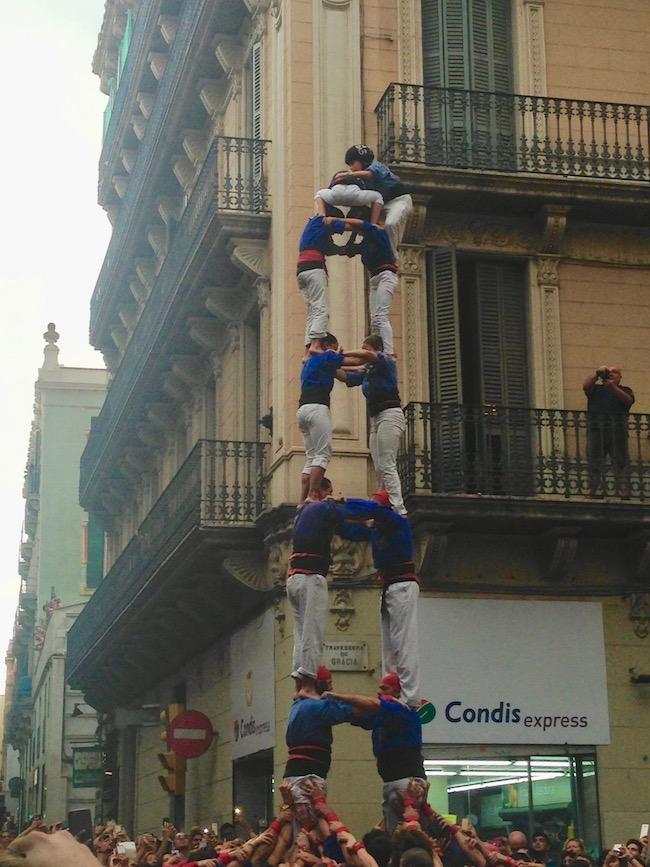 Castellers on Travessera de Gràcia and Torrent de l'Olla