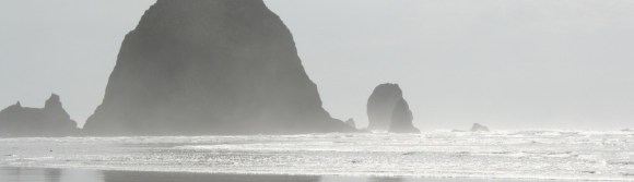 Canon Beach, OR. It was overcast for most of the day, towards the afternoon the sun began to peek out, warming the sand and air. I had gone to Portland to visit a friend for the weekend and we decided to drive out to Canon on that Sunday. It was an amazing visit, and that day at the beach was stellar.