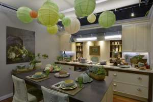 Transitional kitchen designed by Lifestyles and Interiors by Lisa and decorated with festive lime and white paper lanterns.