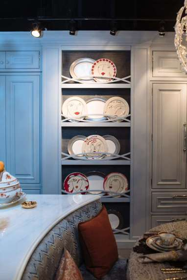 china displayed in a kitchen with custom blue cabinetry