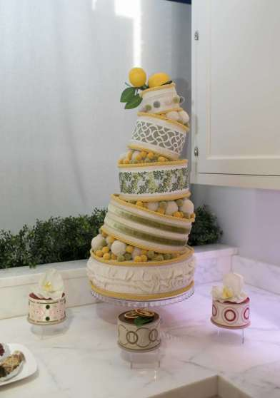 multi-tiered cake with yellow and white icing