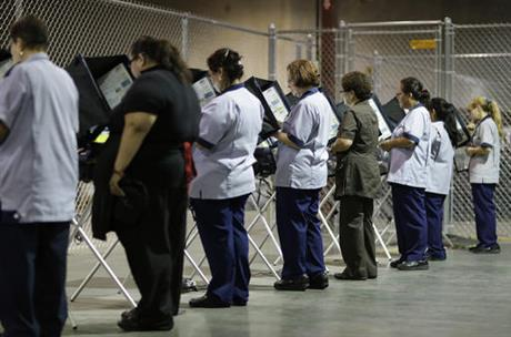 Casino workers vote at an early voting polling station in October 2016. (AP photo)