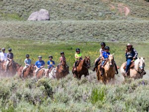 Trail riding on horseback at Roosevelt Lodge.