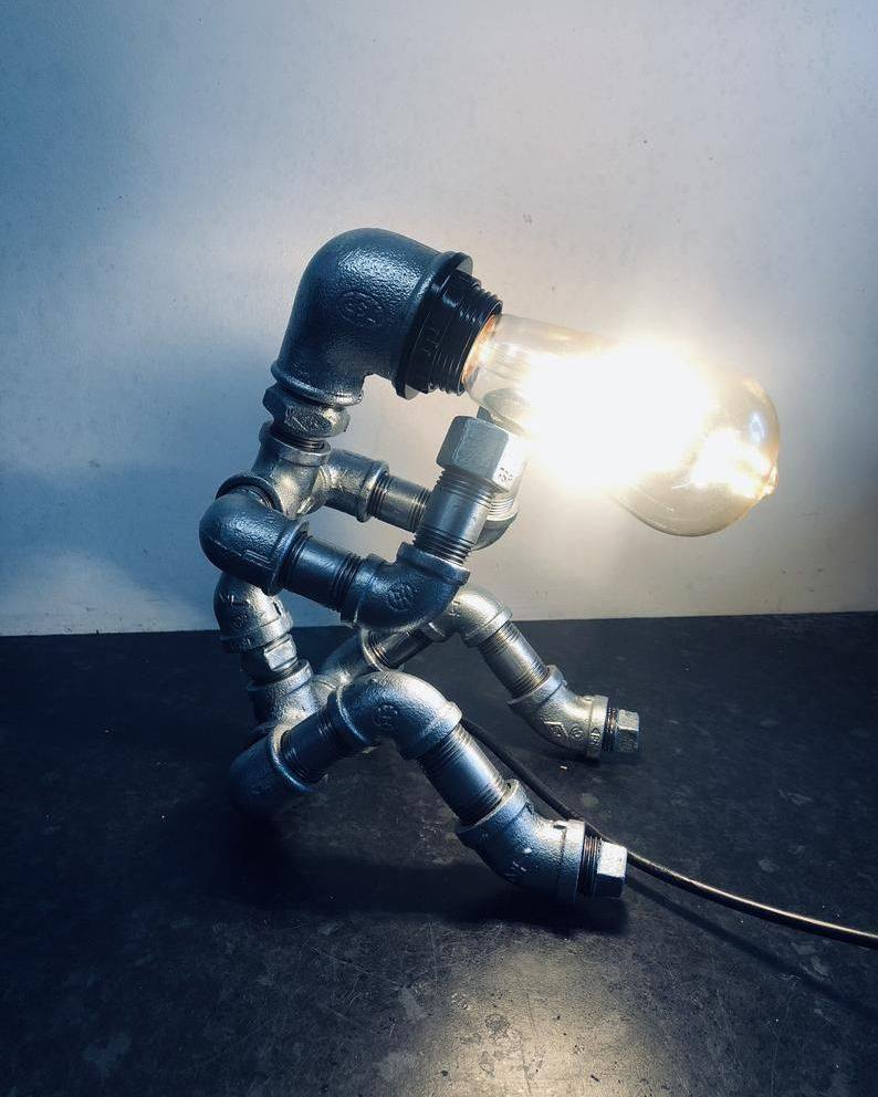 "Industrial Steampunk ""Thinking Man"" Robot lamp.⁣"
