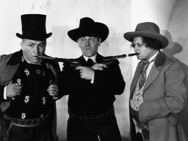 The Three Stooges, two with guns in their mouths.