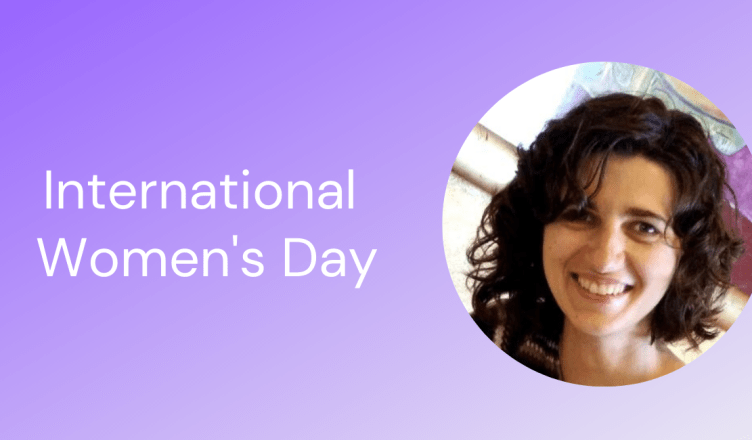 International Womens day with a purple background featuring a woman with brown hair smiling