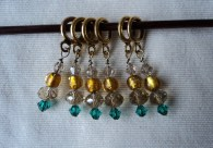 Gold and blue sparkly stitch markers