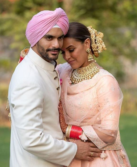 Angad Bedi with his Wife