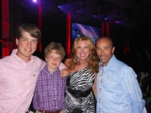 Lee Greenwood with his wife and two children.
