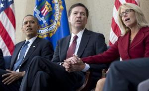 Former FBI director James Comey with his wife Patricia and 44th US President Barrack Obama.